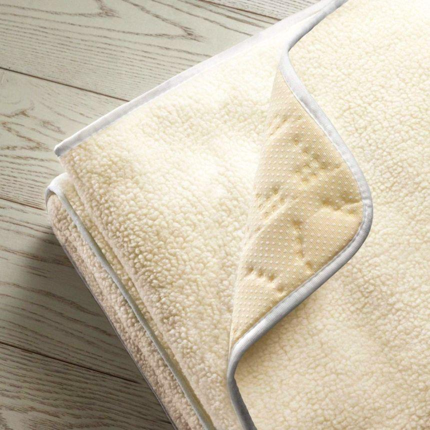 Lo Scaldasonno Imetec Adapto in calda lana e merino, naturale, traspirante, ideale per garantirvi un sano tepore per tutta la notte